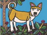 秋田犬とタンポポ